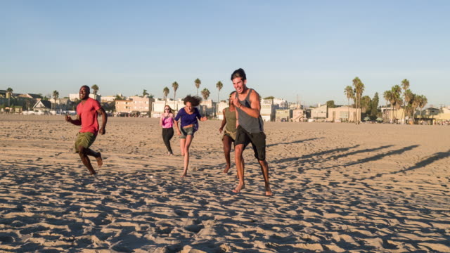 Group of young people having fun in the beach