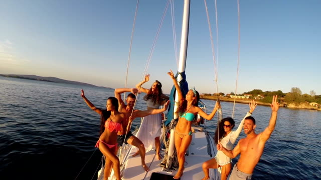 group of young people having fun on yacht - yacht stock videos & royalty-free footage