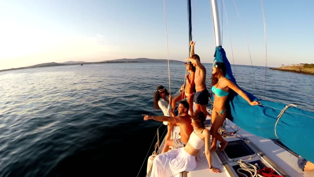 Group of young people having fun on yacht