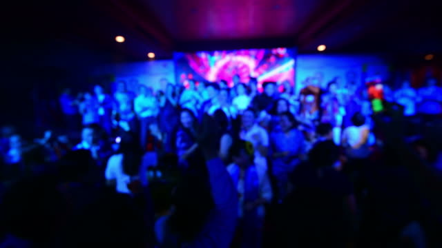 group of young people having joyful dancing in nightclub party - the morning after stock videos and b-roll footage