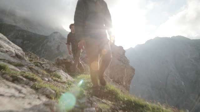 group of young people hiking in the alps - austria video stock e b–roll