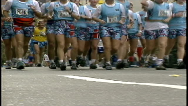 Group of Young People in Matching Uniforms Going Past Camera