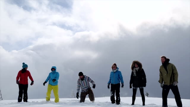group of young people jump in the snow - medium group of people stock videos & royalty-free footage
