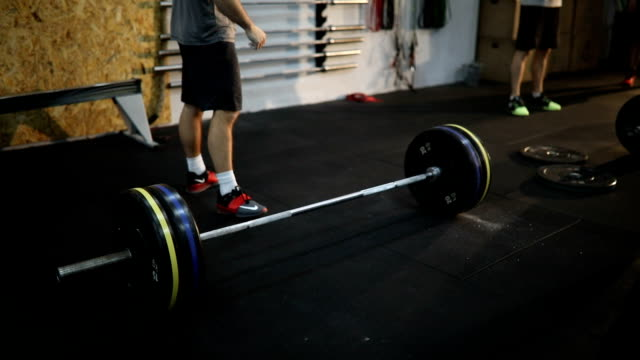 group of young people lifting weights on cross training - attrezzatura per esercizio fisico video stock e b–roll