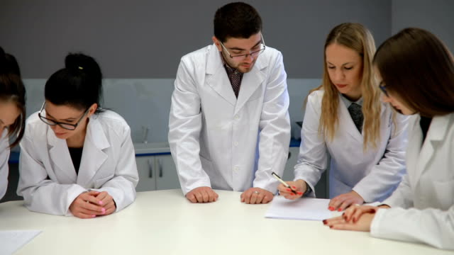 Group Of Young Scientists in the lab