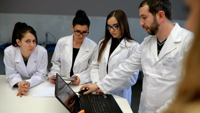 Group Of Young Scientists Making Device For Measurement Of Air