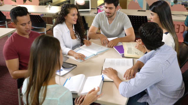 group of young students studying and discussing a subject - university student stock videos & royalty-free footage