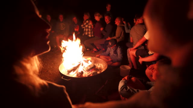 group of young teens around a bonfire at night - 20 29 years stock videos & royalty-free footage