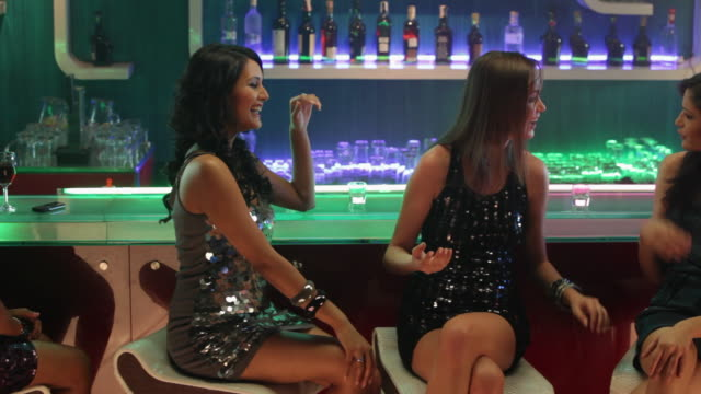 group of young women enjoying at bar counter - gossip stock videos & royalty-free footage
