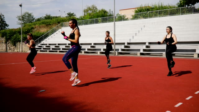 group of young women exercise aerobic outdoors - instructor stock videos & royalty-free footage