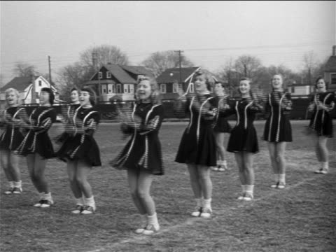 b/w 1953 group of young women in cheerleading outfits practicing cheerleading routine / documentary - cheerleader stock videos & royalty-free footage