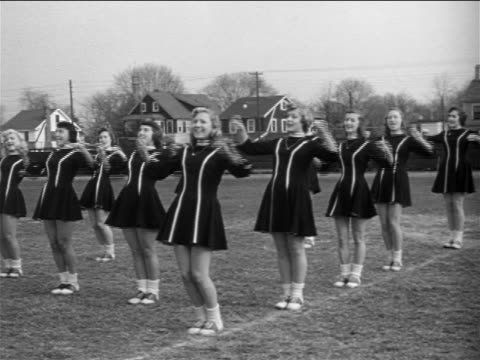 b/w 1953 group of young women in cheerleading outfits practicing cheerleading routine / documentary - cheerleader stock videos and b-roll footage