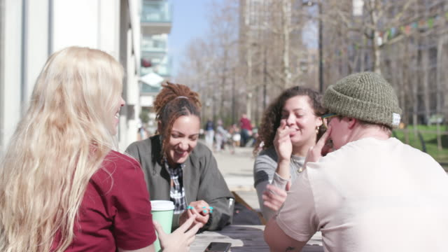 group of young women outside, eating and drinking together - food and drink stock videos & royalty-free footage