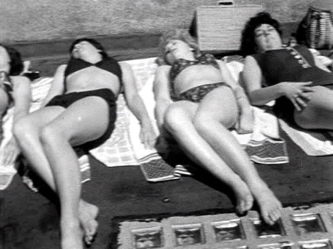 a group of young women sunbathe - girls videos stock videos & royalty-free footage