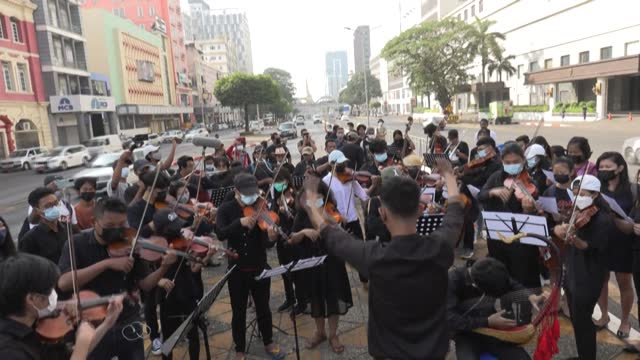 """vídeos de stock, filmes e b-roll de group of youth-led musicians called """"generation z mm"""" in myanmar's yangon showcase their new protest song simple titled """"revolution"""", aimed at... - generation z"""