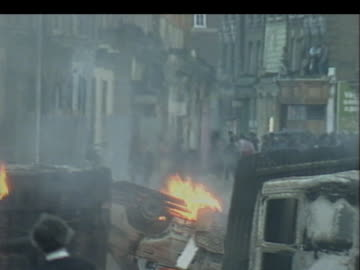 group of youths gather behind barricade of overturned cars on fire brixton riots; 2 april 1981 - 1981 stock videos & royalty-free footage