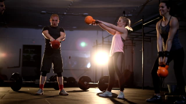 Group pf people doing a kettlebell workout together