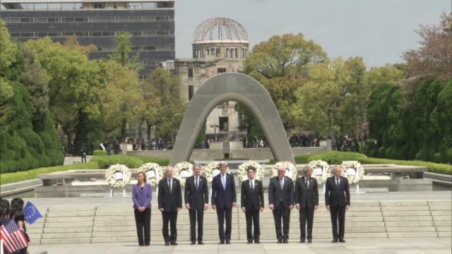 group photo session of g7 ministers after floral tribute at memorial cenotaph in hiroshima peace memorial park. - armi di distruzione di massa video stock e b–roll