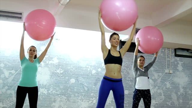 group pilates training! - fitness ball stock videos & royalty-free footage