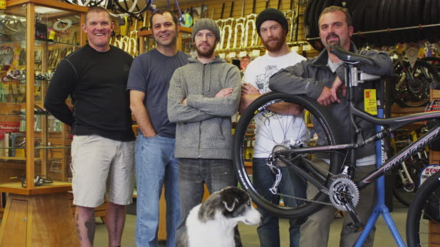 MS Group portrait of bike shop employees and owner / Portland, Oregon, USA