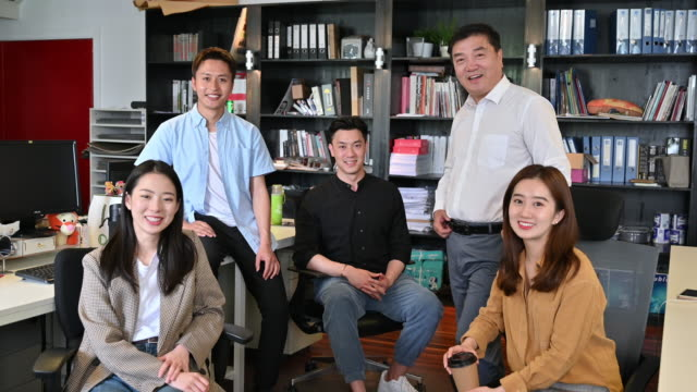 group portrait of chinese small business colleagues - small group of people stock videos & royalty-free footage