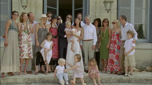 WS, Group portrait of just married couple surrounded with wedding guests outdoors, Chateau du Parc, Saint Ferme, France