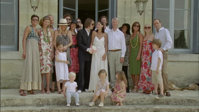 ws, group portrait of just married couple surrounded with wedding guests outdoors, chateau du parc, saint ferme, france - mixed age range stock videos & royalty-free footage