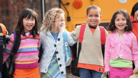 ms pan group portrait of school students (4-7) standing in a row in front of school bus / richmond, virginia, usa - mixed race person stock videos & royalty-free footage