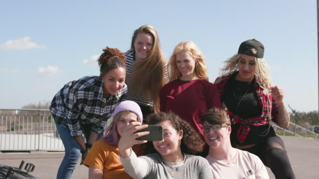 group portrait of young female bmx riders hanging out together taking a selfie - 20 29 years stock videos & royalty-free footage