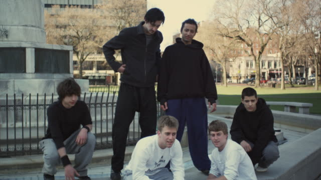 ms group portrait of young men and boys (16-17) in park, new haven, connecticut, usa - ニューヘイブン点の映像素材/bロール