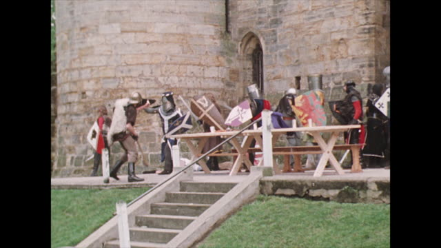 a group re-enact a battle between normans and vikings; 1975 - battle stock-videos und b-roll-filmmaterial