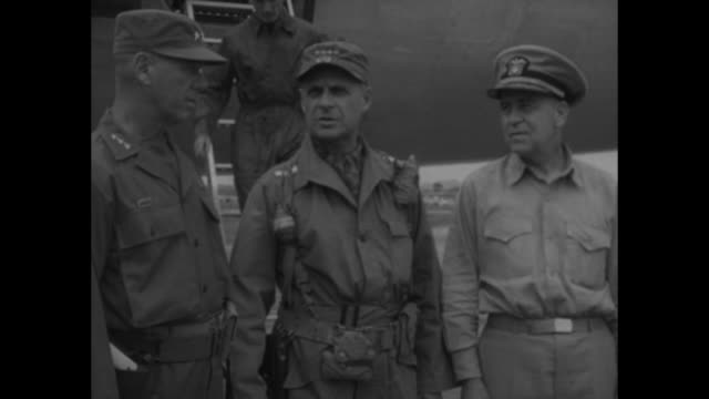 group shot in front of military airplane after arrival from tokyo: gen. james van fleet , gen. matthew ridgway, usn adm. c. turner joy, usaf maj.... - vangen stock-videos und b-roll-filmmaterial