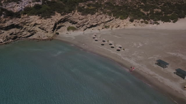 group sunbathes on remote beach in greece - 40 49 years stock videos & royalty-free footage