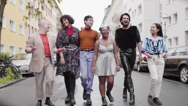 lgbtq group walking on city street - front view stock videos & royalty-free footage