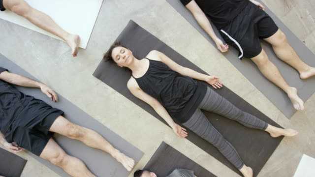 group yoga - lying on back stock videos & royalty-free footage