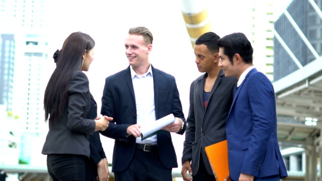 group young business workers communicate and planing new start up business project at  outside - employee engagement stock videos & royalty-free footage