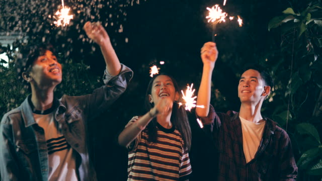 group youngs with sparklers dancing - sparkler stock videos & royalty-free footage