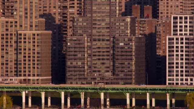 stockvideo's en b-roll-footage met a grouping of architectural buildings on the west side of manhattan during dusk. - gevel