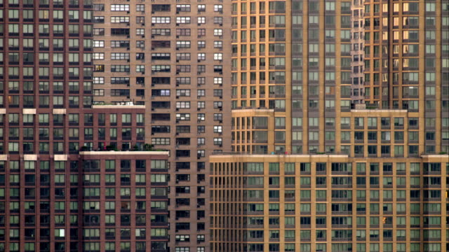 grouping of new york city buildings create pattern of windows and lines. - wohnung stock-videos und b-roll-filmmaterial