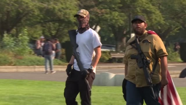 groups of armed men in paramilitary gear are among hundreds of president donald trump's supporters that stage a motorcade near the protest-hit us... - weaponry stock videos & royalty-free footage