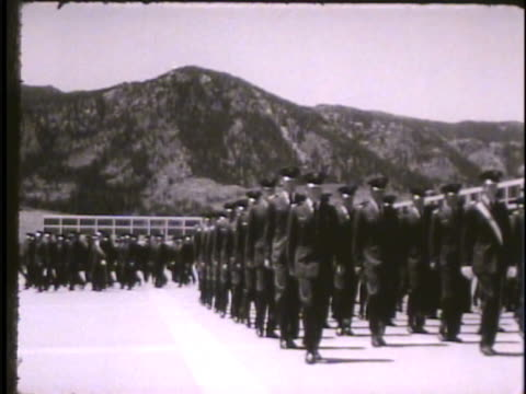 Groups of cadets walking across courtyard base marching in formation marching across Cadet Area toward Mitchell Hall Colorado CO Rampart Range doolies