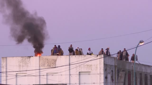 groups of inmates rioted and climbed onto the roofs of prisons in the province of buenos aires, argentina, demanding permits to receive visitors amid... - buenos aires province stock videos & royalty-free footage