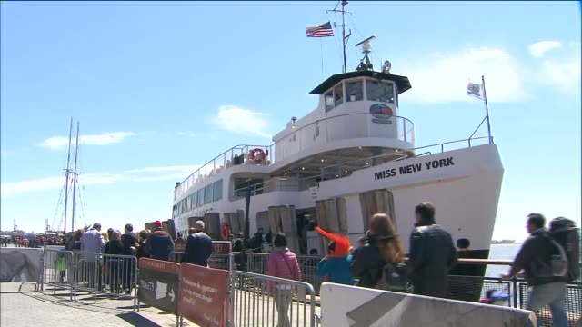 vidéos et rushes de groups of people in line to purchase tickets for the statue of liberty ferry and miss new york vessel april 25 2015 in new york city - bateau de voyageurs