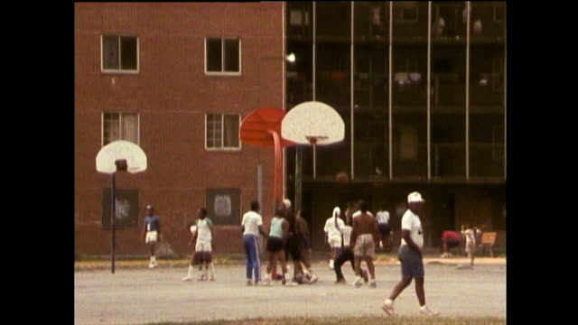 groups of people playing games in chicago; 1989 - bbc archive stock-videos und b-roll-filmmaterial
