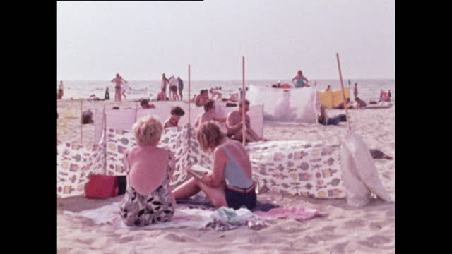 groups of people relax on warnemunde beach in germany; 1970 - germany stock videos & royalty-free footage