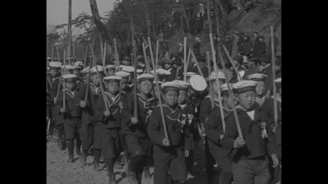 vs groups of schoolchildren boys in scout uniforms and boys in sailor suits march along country road i honor of birth of prince akihito / vs they... - japanese school uniform stock videos & royalty-free footage