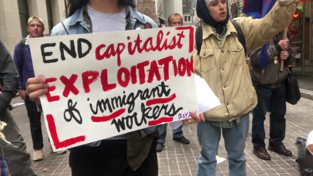 groups of socialists participate in a protest outside of a trump owned building on may day on may 01, 2019 in new york city. around the country and... - other stock videos & royalty-free footage