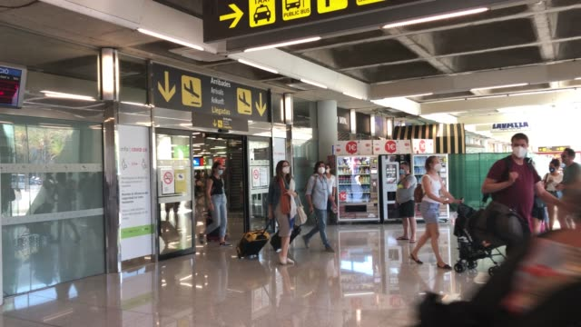 groups of tourists arrive at palma de mallorca airport on august 7, 2020 in palma de mallorca, spain. almost all schengen countries recommend not... - majorca stock videos & royalty-free footage