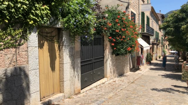 groups of tourists walk through the village of valldemosa on august 9 2020 in palma de mallorca spain almost all schengen countries recommend not... - palma stock videos & royalty-free footage