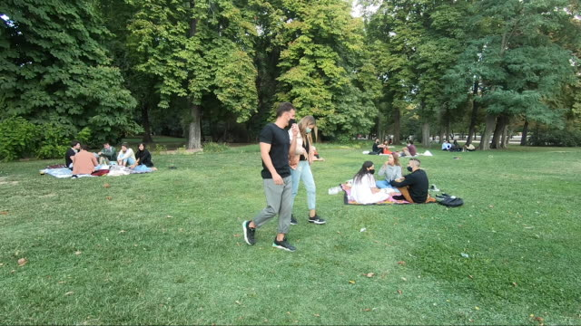 groups of young people wear face masks on the grass outdoors at retiro park on august 29, 2020 in madrid, spain. since mid-july, the coronavirus rate... - leisure activity stock videos & royalty-free footage